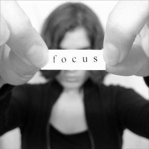 Girl holding focus sign